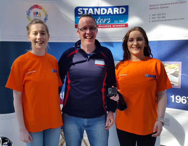 Go-Pro Camera Competition winners Laura and Laura, with Gary Dunne of Standard Printers